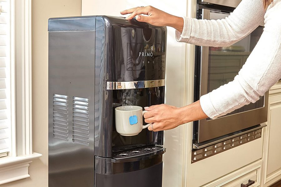 Filling up hot water with a Primo bottom load water dispenser